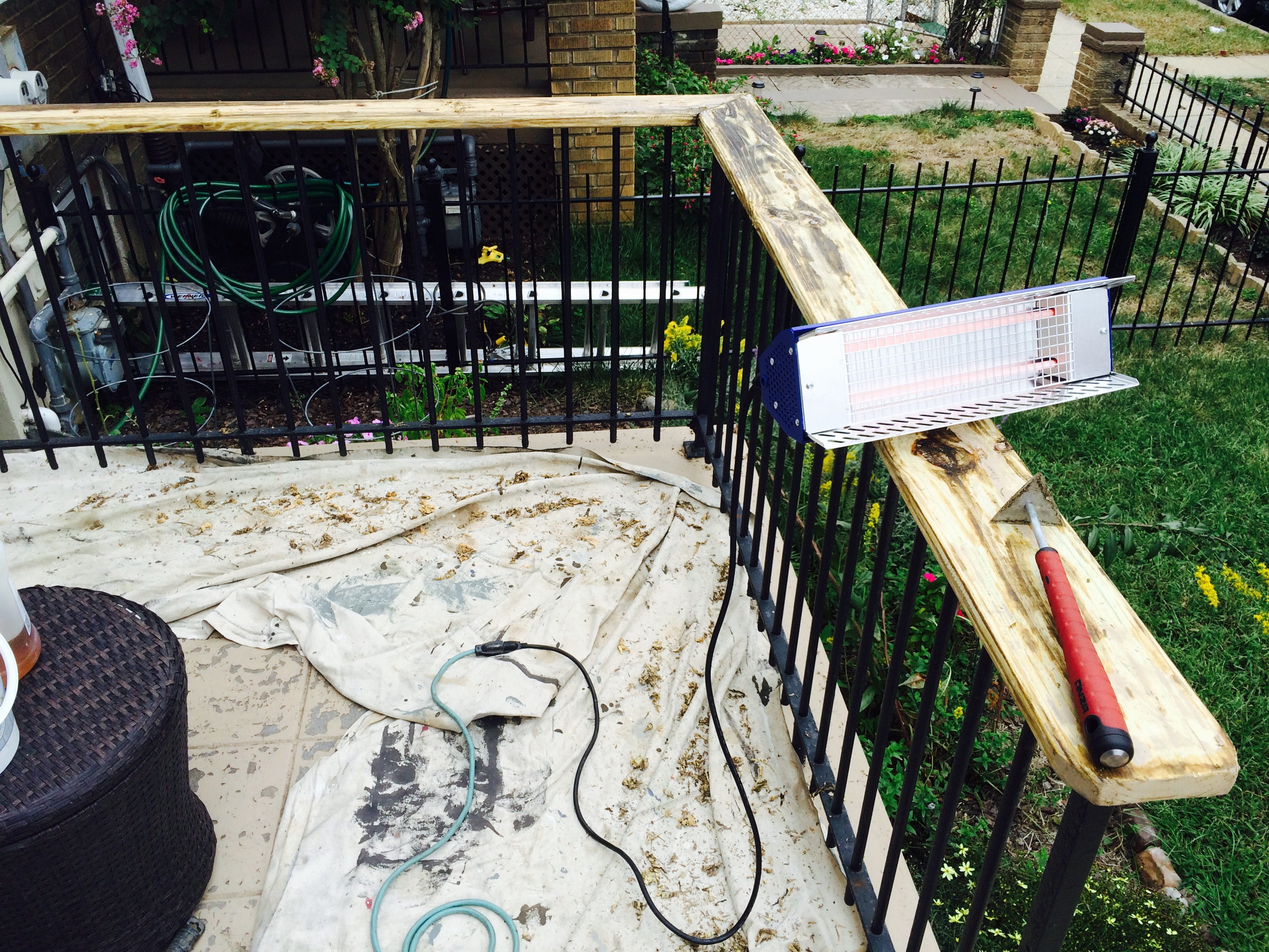 pressure treated railing finished with linseed oil varnish swab