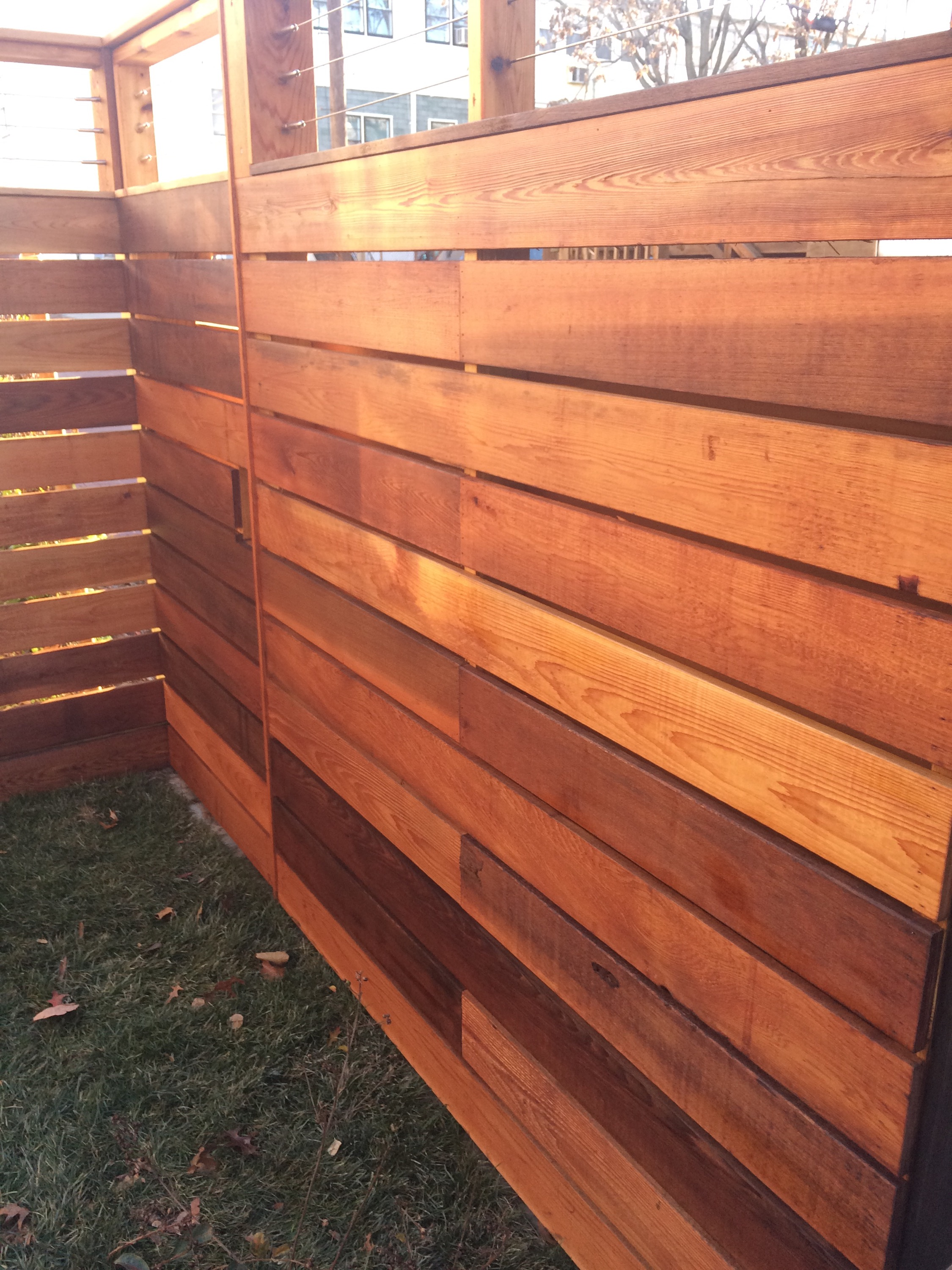 Cedar fence mahogany deck finished with raw linseed oil